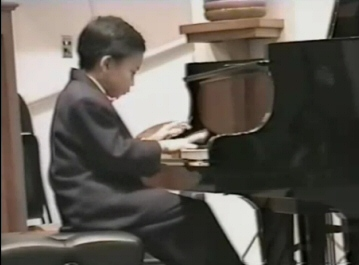 Kit Armstrong at age 8 plays Bach--click here to view